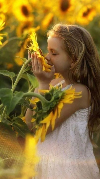 child with sunflower - holistic healthcare